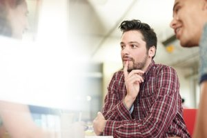 Man paying attention to speaker from residential alcohol addiction treatment centers